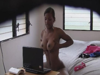 Aroused latina bitch teases, strips and dances in front of her laptop