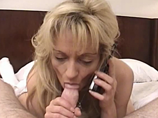 blonde milf talking in phone and suck the cock