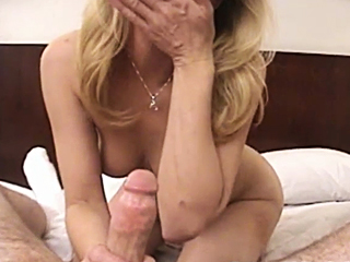 sexy milf giving her boytoy a blow job