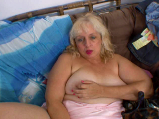 mature woman fingering alone