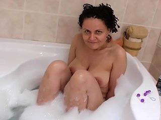 Husband films his wife taking a bath ends up take some pussy beads play